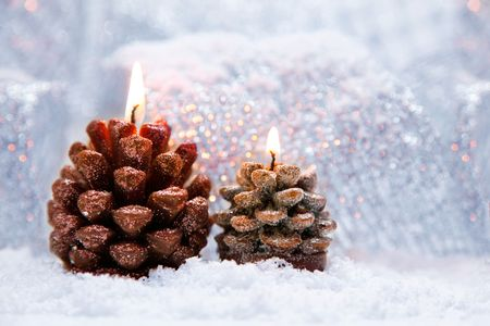 conflagrant: Christmas holiday decoration with white snow and by conflagrant candles