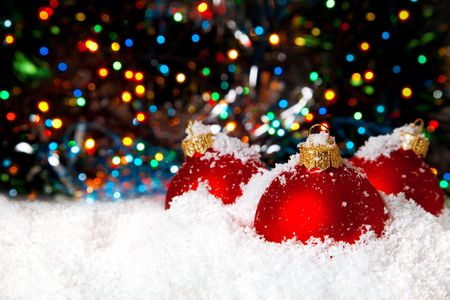 newyear night: Christmas holiday decoration with white snow festive tinsel and red bowls