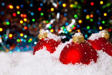 newyear night: Christmas holiday decoration with white snow and festive red bowls Stock Photo