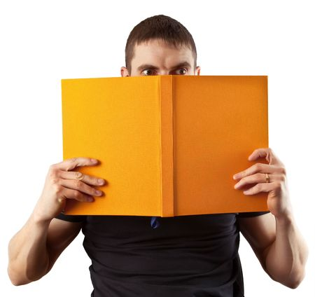 frightful: young student reading a frightful book isolated on background Stock Photo