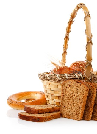 fresh bread in the basket isolated on white background photo