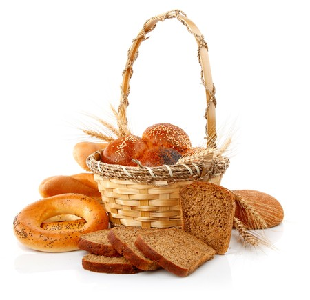 fresh bread with corn in the basket isolated on white background photo