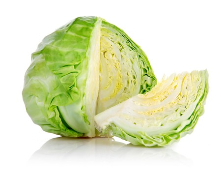 fresh green cabbage with cut isolated on white background photo