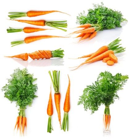 carrots isolated: set fresh carrot fruits with green leaves isolated on white background