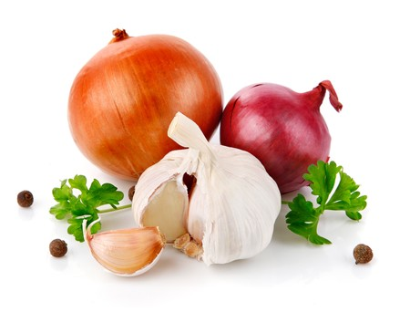 onion isolated: fresh garlic fruits with green parsley isolated on white background Stock Photo