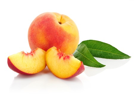 the peach: fresh peach fruits with cut and green leaves isolated on white background