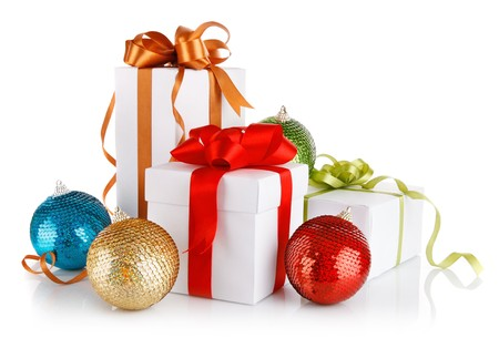 christmas gifts in with variegated bows and balls isolated on white background photo
