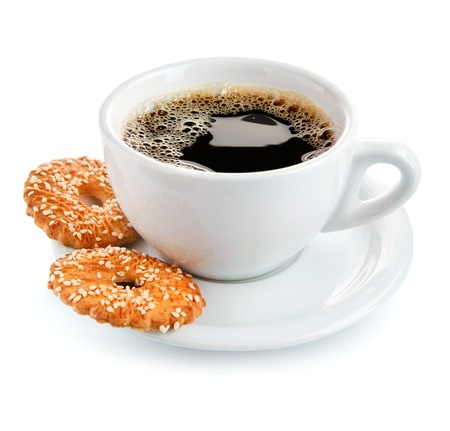 cup of coffee on saucer with biscuits isolated white background