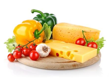 yellow cheese with fresh vegetables isolated on white background Standard-Bild