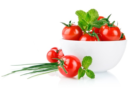 fresh tomatoes with green leaf isolated on white background photo