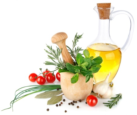 sunflower oil: fresh spice with vegetables and olive oil isolated on white background Stock Photo