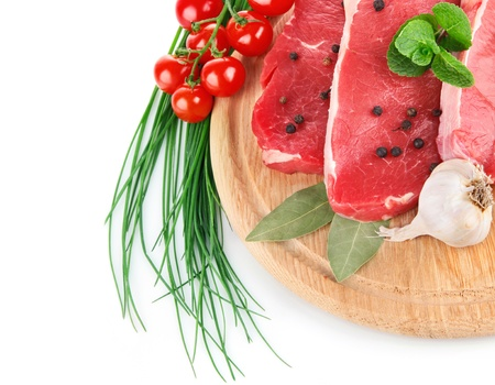 meat dish: raw meat with fresh vegetables isolated on white background