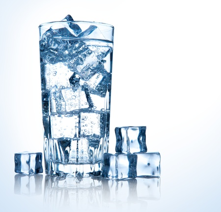 full glass of fresh cool transparent water with ice