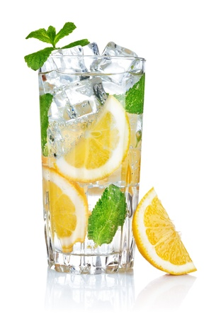 full glass of fresh cool transparent water with lemon and mint leaves photo