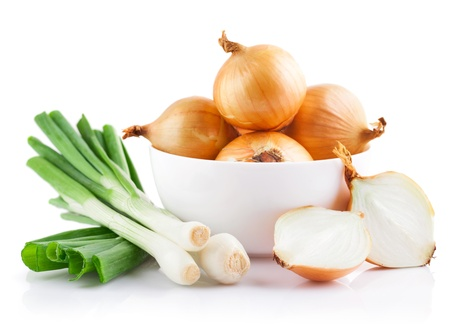 onions vegetables in white plate with cut isolated on white background Standard-Bild