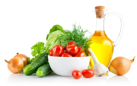 set fresh vegetables with olive oil isolated on white background Stock Photo - 9713253