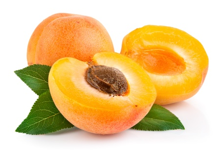 apricot fruits with green leaf and cut isolated on white background