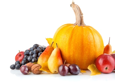 autumnal fruit with yellow leaf isolated on white background