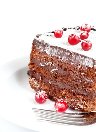 sweetmeats: chocolate cake with berry isolated on white background