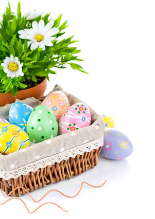 insulate: easter egg in basket with spring flower isolated on white background Stock Photo