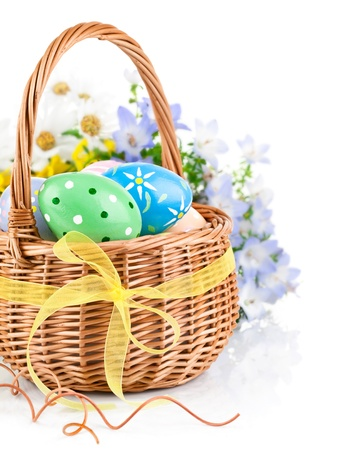 easter basket: easter egg in basket with spring flower isolated on white background Stock Photo