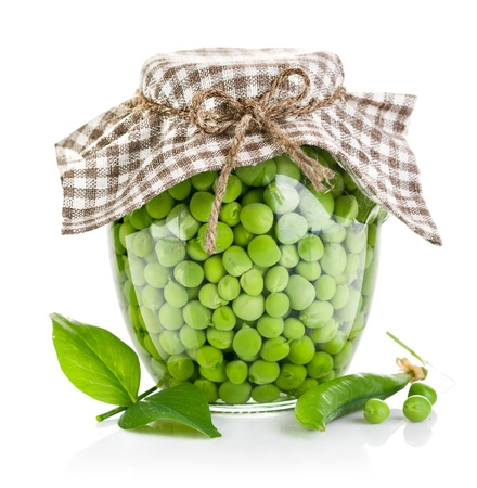 canned peas: green peas in glass jar isolated on white background