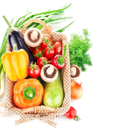 fresh vegetables with leaves in the basket isolated on white background photo