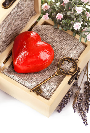 red heart with key in retro box isolated on white background photo