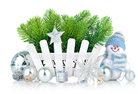 christmas tree with snowman and silvery balls isolated on white background photo