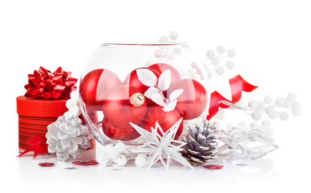christmas red ball with festive tinsel isolated on white background photo