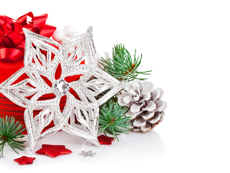 tree vertical: christmas tinsel with branch firtree and red gift isolated on white background Stock Photo