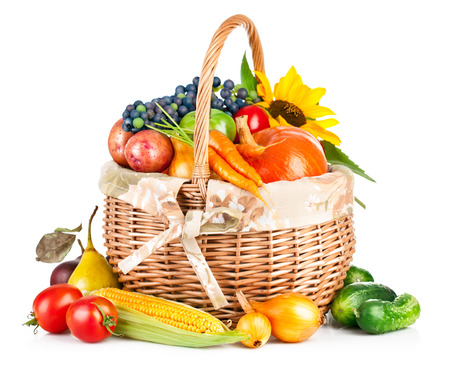 autumnal harvest vegetable and fruit in basket isolated on white background photo