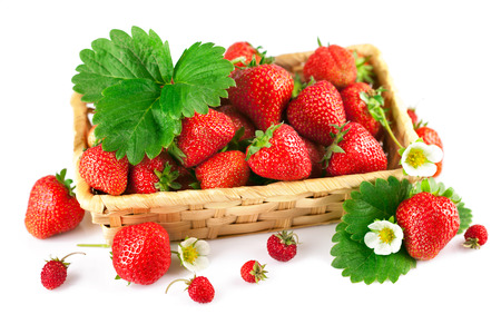Basket fresh strawberry with green leaf and flower. Isolated on white background photo