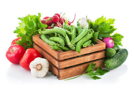 Fresh vegetable with greens. Isolated on white background