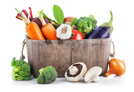 wooden basket: Harvest vegetables in wooden basket. Isolated on white background