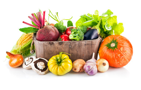 Fresh vegetables in wooden bucket with leaf lettuce. Isolated on white background photo