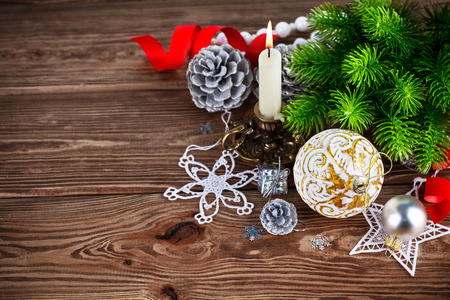 Branch of Christmas tree with candle and balls photo