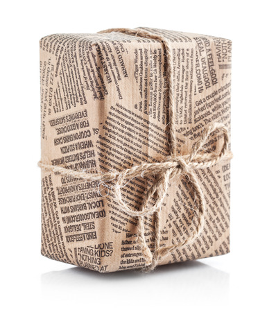 Box packaged newspaper with bow of rope. Isolated on white background