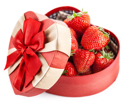 unexpectedness: Fresh strawberries in box with bow gift on valentines day. Isolated on white background