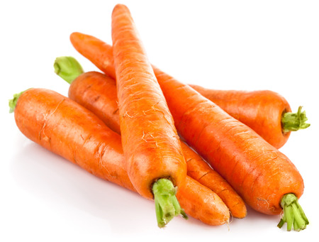 Fresh carrot with green leaves. Isolated on white background Standard-Bild