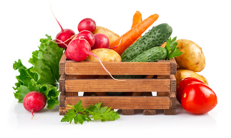 Fresh vegetables in wooden box. Isolated on white background