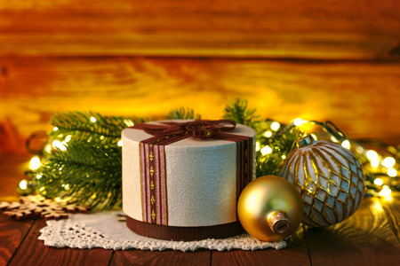 unexpectedness: Christmas gift with ball and garland Stock Photo