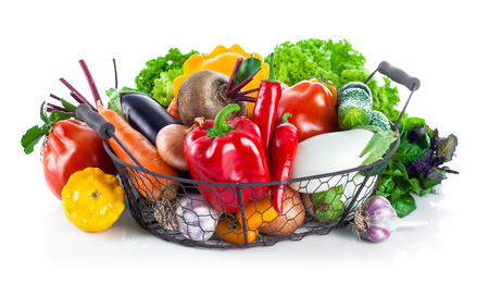 Fresh vegetables in basket. Isolated on white background