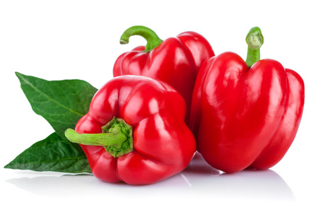 fruit and vegetables: Fresh peppers with green leaves. Isolated on white background Stock Photo