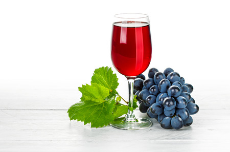 cluster: Glass red wine with cluster grapes