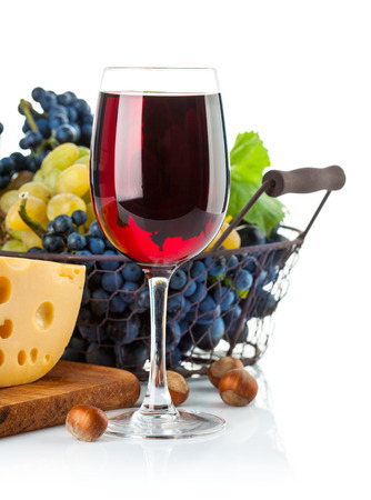 spirituous beverages: Glass red wine with grapes and cheese. Isolated on white background