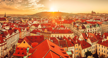 city view: Top view to red roofs skyline of Prague city Czech republic