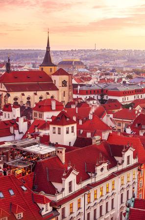 flue season: Top view to red roofs skyline of Prague city Czech republic
