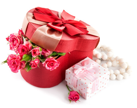 unexpectedness: Gift with bunch roses on valentines day. Isolated on white background