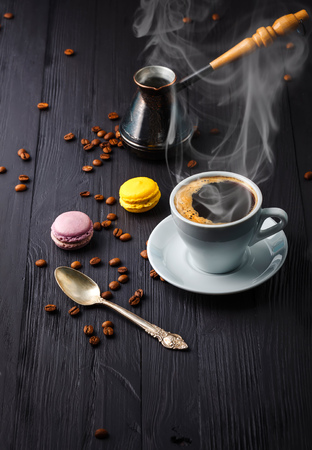cezve: Cup coffee with grain and cezve on wooden board